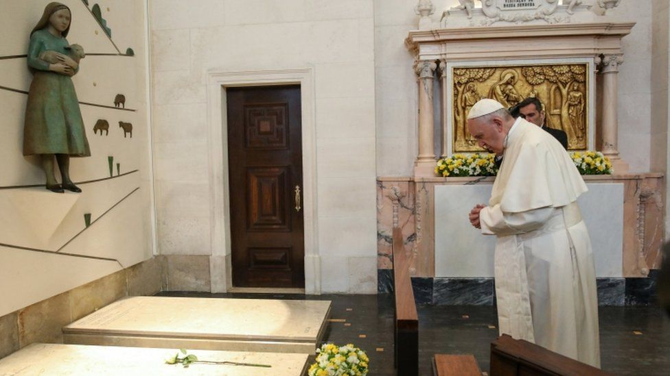 Pope Francis prays on the grave of Francisco Marto and Jacinta, two of the three shepherd children, at the Our Lady Rosario Cathedral in the Fatima Sanctuary, Portugal, 13 May 2017