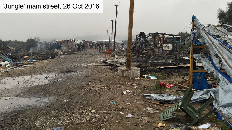 """Main street in """"Jungle"""" camp on 26 October shows shelters and shops flattened"""