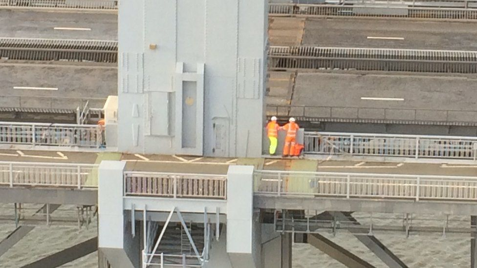 Workmen on bridge
