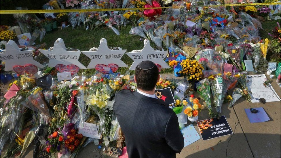A man prays at a makeshift memorial outside the Tree of Life synagogue
