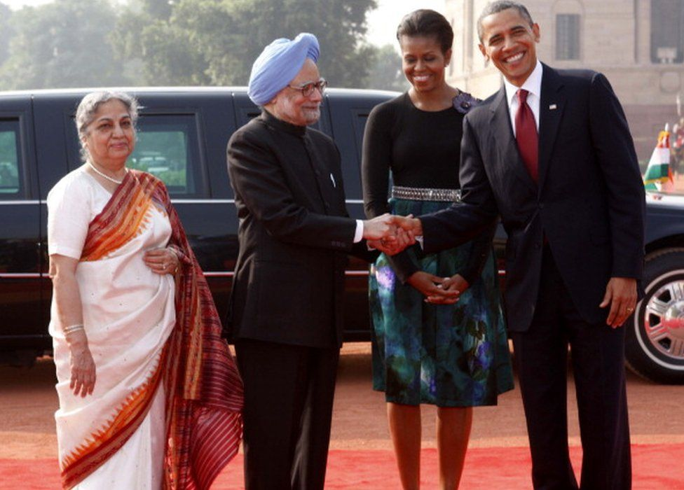 PM Manmohan Singh shakes hands with US President Barack Obama, as their better halves