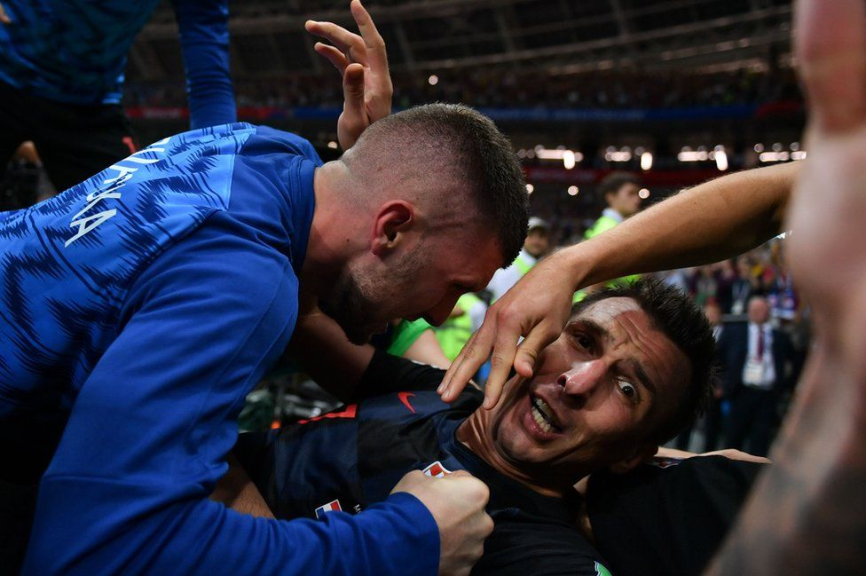 Croatia's forward Mario Mandzukic (C) celebrates with teammates after scoring his team's second goal during the Russia 2018 World Cup semi-final football match