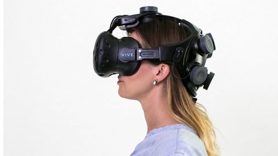 Woman wearing Neurable headset
