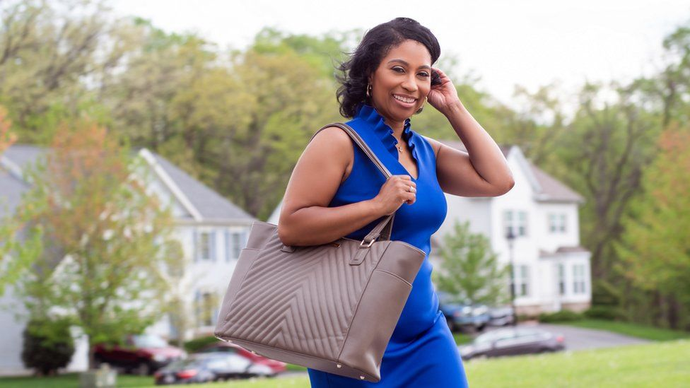 Sherrill Mosee models a MinkeeBlue tote bag