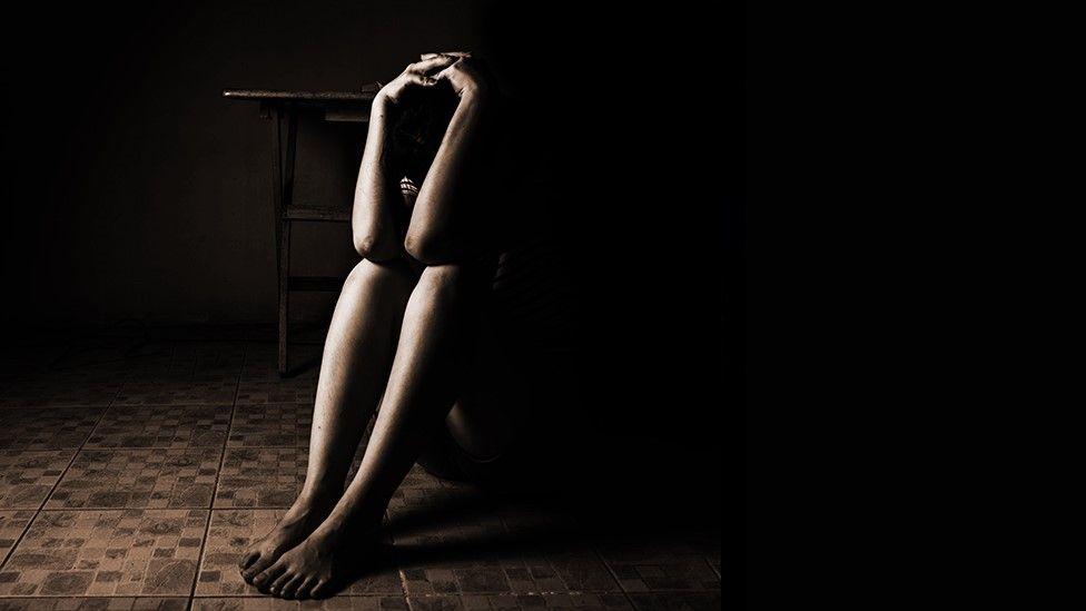 Woman sat on a floor