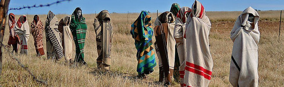 Boys from the Xhosa tribe who have undergone a circumcision ceremony walk near Qunu on June 30, 2013.