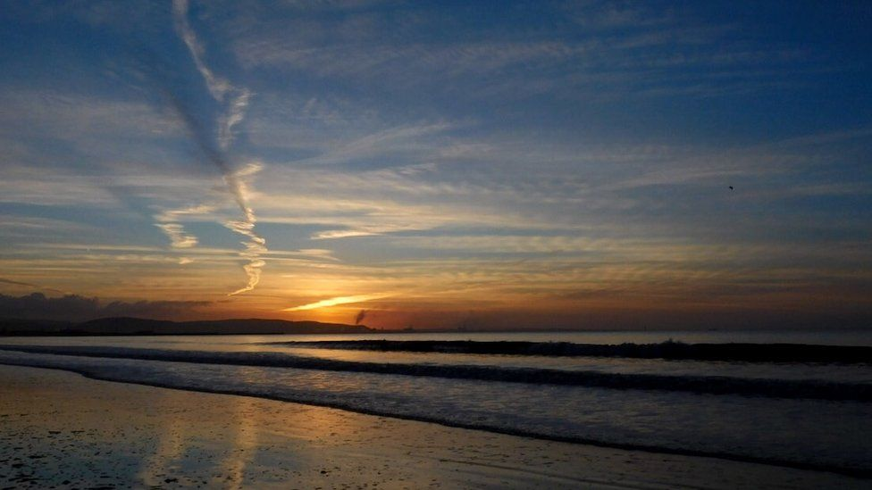 Swansea sunrise - It pays to get up early sometimes, this stunning image of the sun rising over Swansea beach was taken by Lisa Medcalf