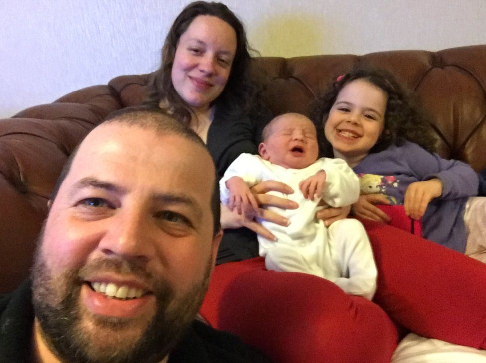 Kayleigh and Colin Griffiths with their one-day-old daughter Pippa and her sister Brooke