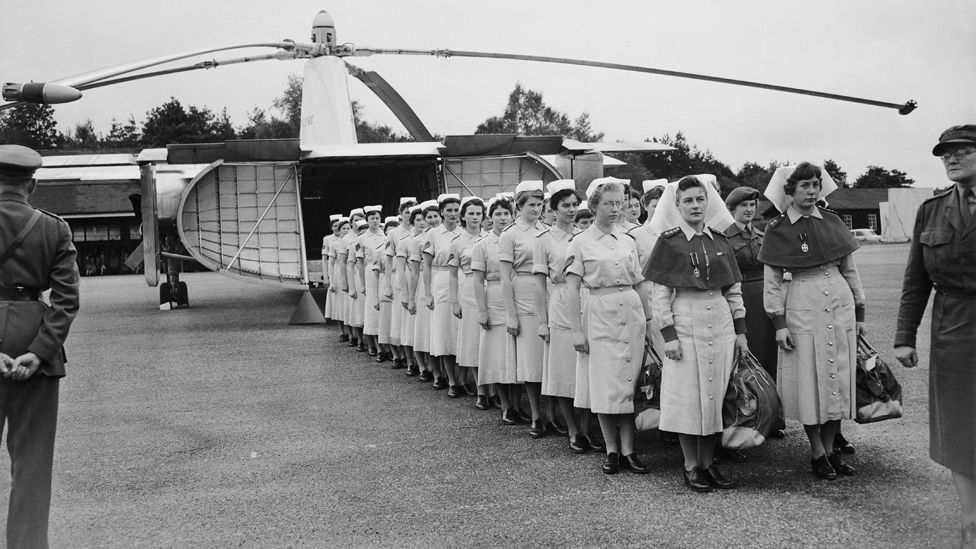 Forty-eight members of the Queen Alexandra's Royal Army Nursing Corps, who form the first women's Field Medical Company, lined up in front of a Fairey Rotodyne vertical take-of aircraft to demonstrate its carrying capacity, October 1958.