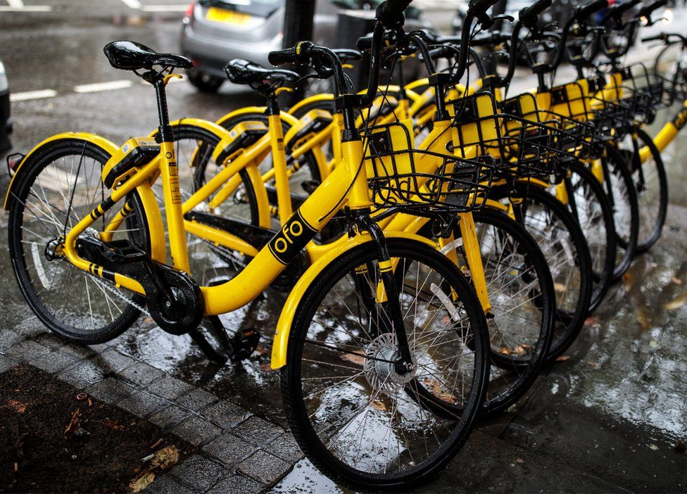 A row of Ofo dockless sharing bicycles on a London pavement in August 2018