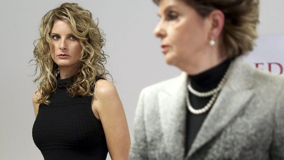 """Summer Zervos (L), with her lawyer Gloria Allred, said she was launching the lawsuit to """"vindicate my reputation"""""""
