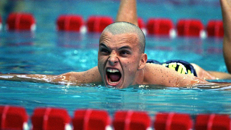 Scott Miller reacts after winning a silver medal in the men's 100m butterfly event at the 1996 Olympics in Atlanta