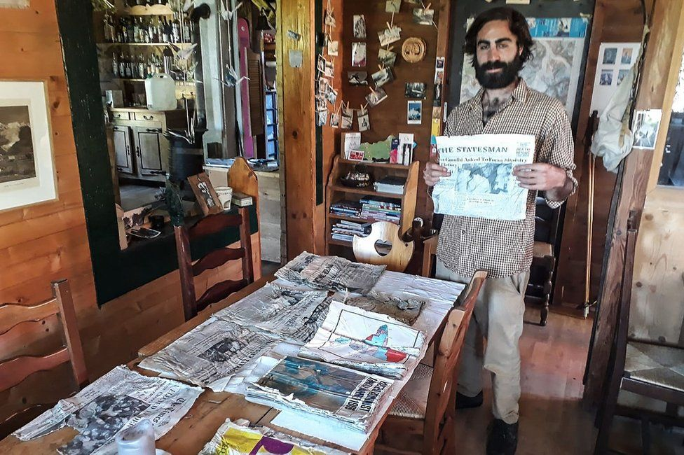 Timothee Mottin with the trove of newspapers