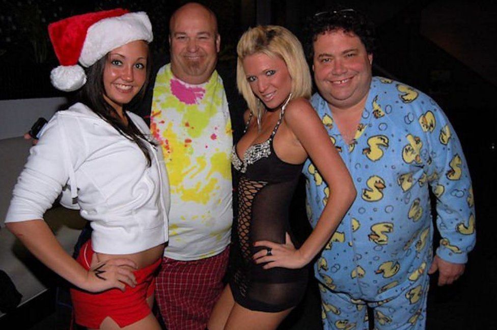 The congressman (right) posed with women at a fancy dress party in 2010