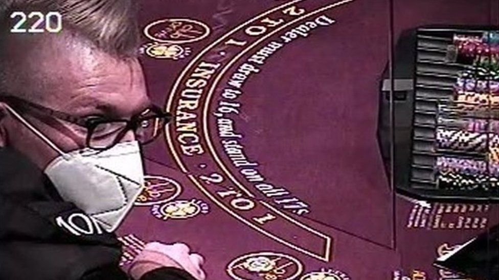 Image issued by the US justice department said to show Andrew Marnell sitting at a blackjack table