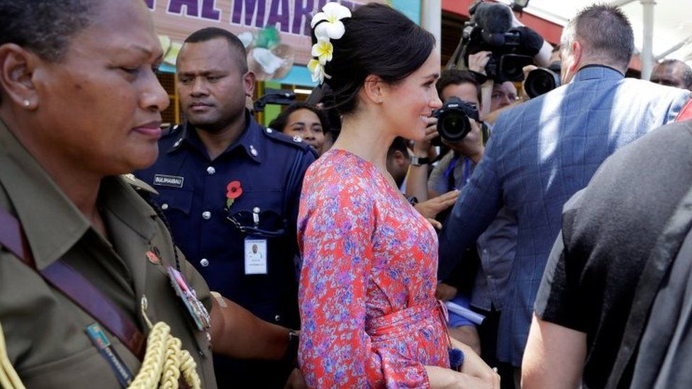 Meghan, Duchess of Sussex, visits a market in Suva, Fiji, Wednesday, Oct. 24, 2018