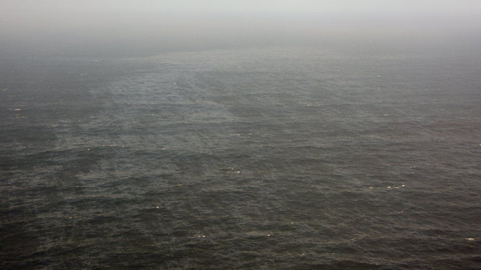 A handout picture of a section of oil slick in the Atlantic Ocean