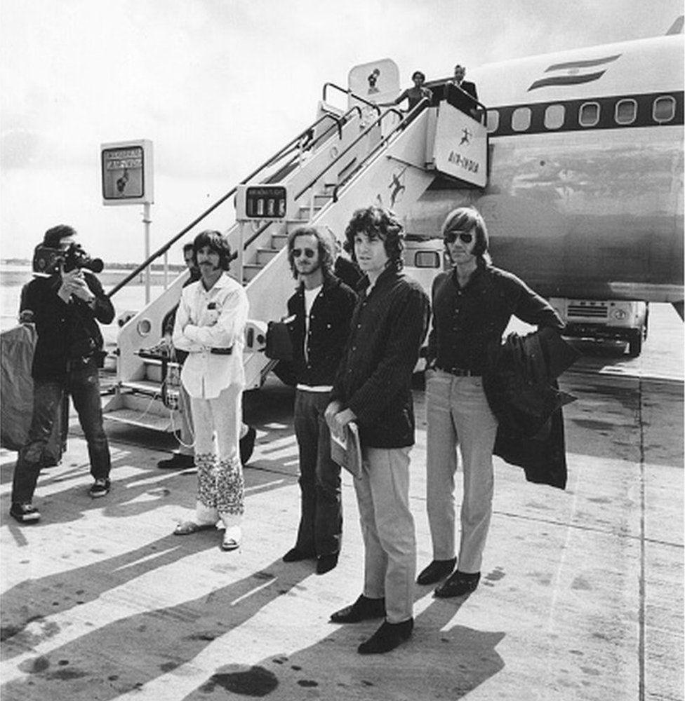 Popular American rock group The Doors standing beside an Air India aeroplane.