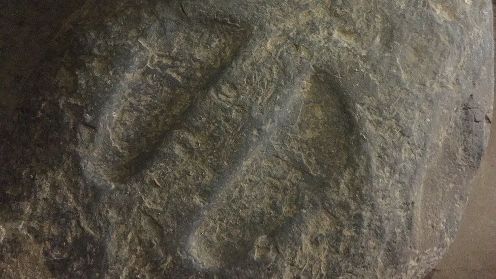 Footsteps carved in stone