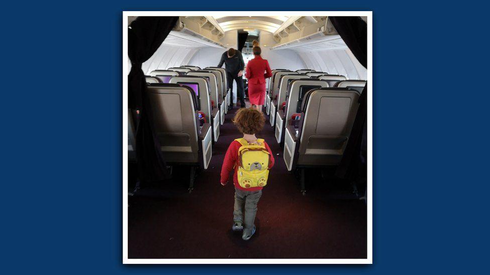 Cheryl's son walks to the cockpit