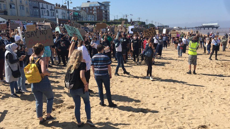 People at a Black Lives Matter protest on Cleethorpes beach