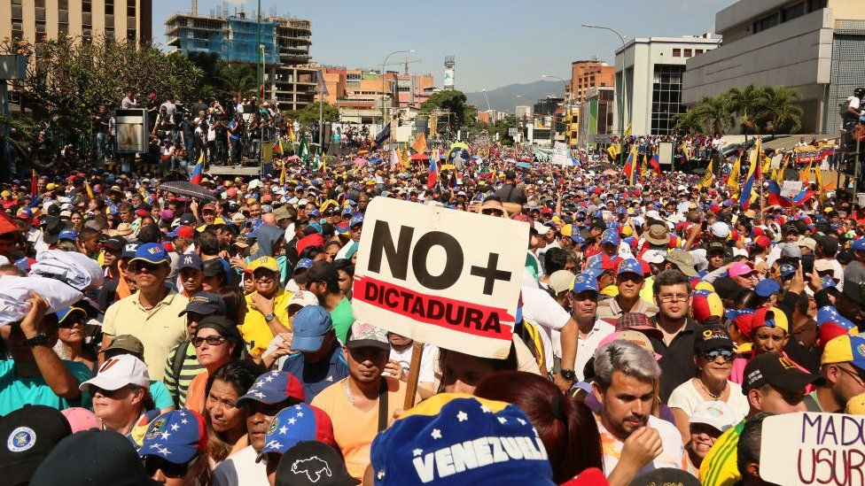 Demonstrators protest against the government of Nicolás Maduro on the Main avenue of Las Mercedes, municipality of Baruta, on February 2, 2019 in Caracas, Venezuela.