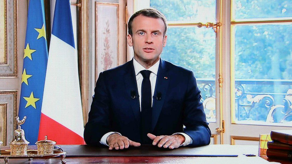 A TV screen displays French President Emmanuel Macron delivering a speech after the results of an independence referendum in the French Pacific territory of New Caledonia. 4 Nov 2018
