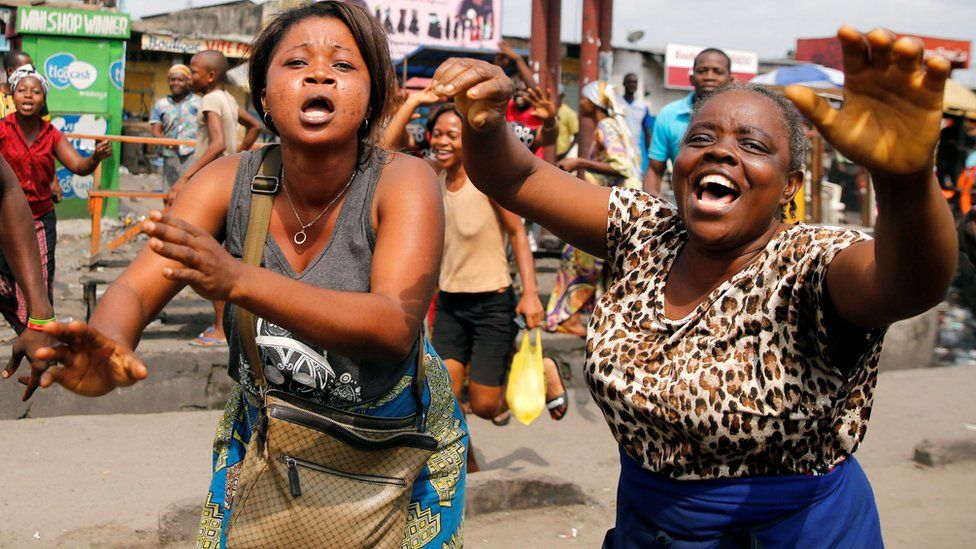 """Residents chant slogans against Congolese President Joseph Kabila during demonstrations in the streets of the Democratic Republic of Congo""""s capital Kinshasa, December 20, 2016."""