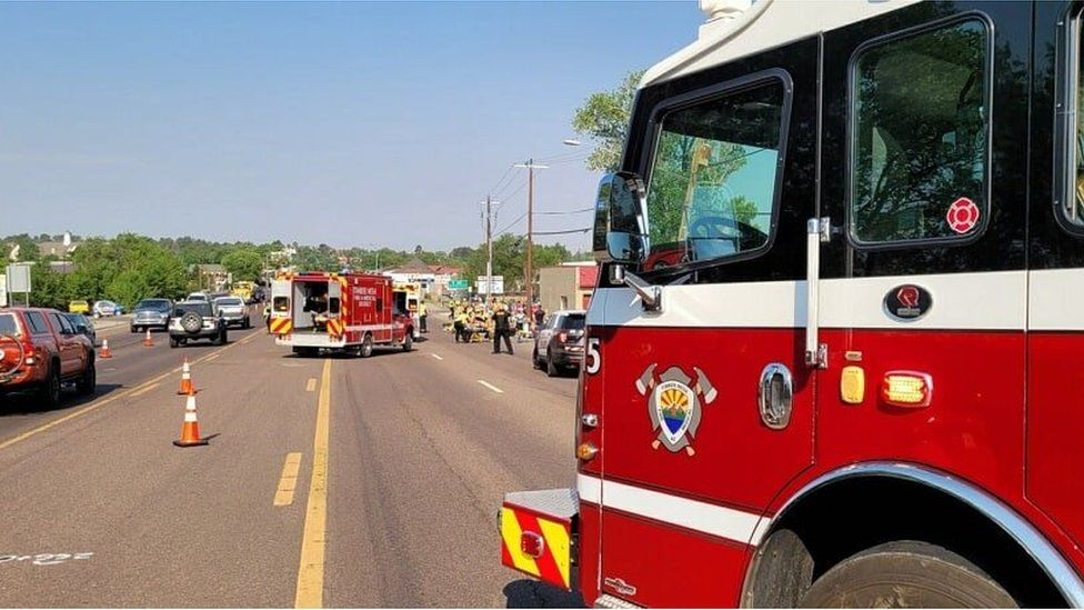 Fire service vehicles and police vehicles at the scene of the incident in Show Low, Arizona