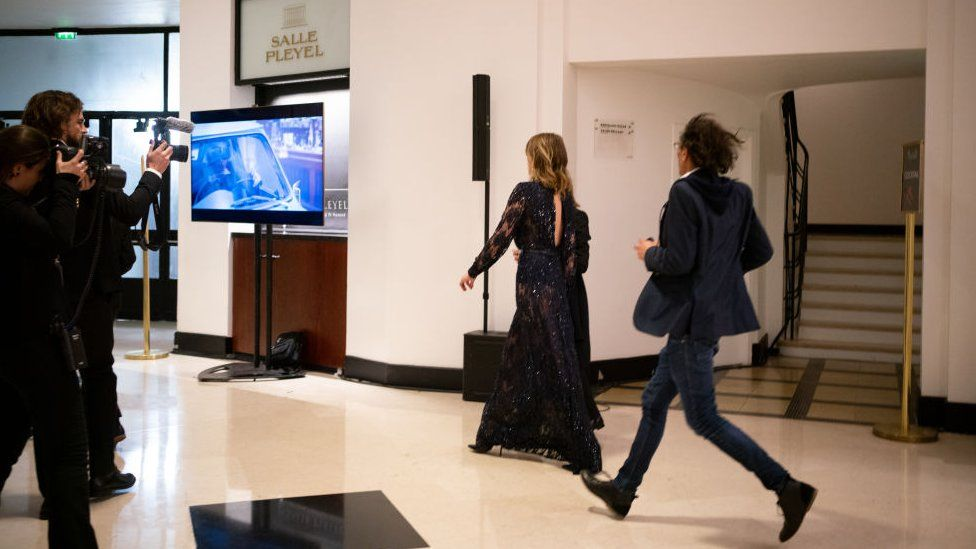 Actress Adèle Haenel leaves the Salle Pleyel after the award for best director was given to Roman Polanski