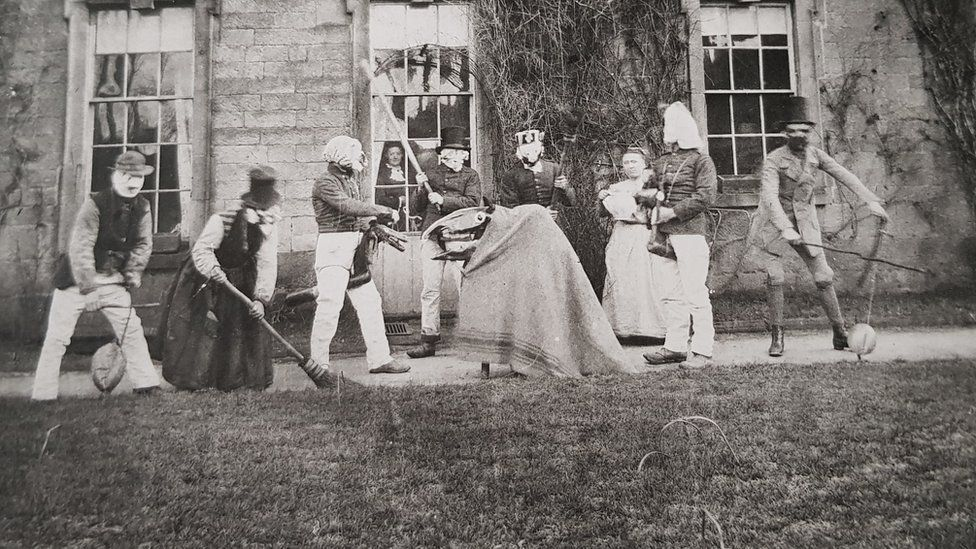 Guisers in Winster from around 1870
