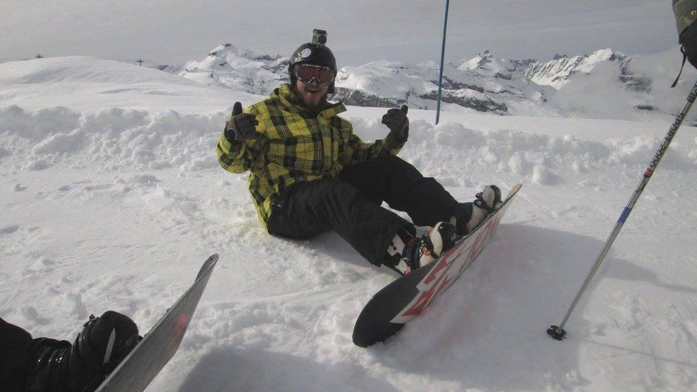 Andy Macleod snowboarding
