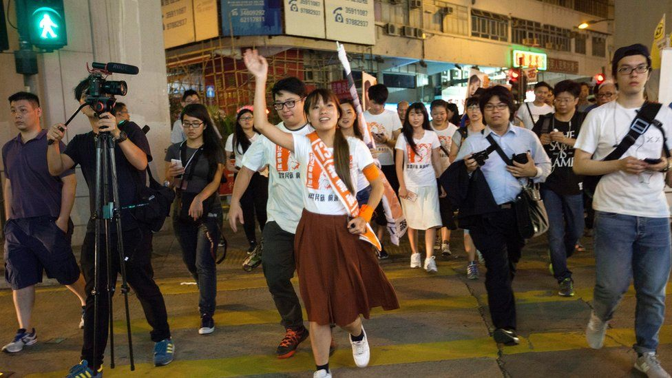 Yau Wai-ching (C) of the Youngspiration political party canvasses for votes in the Kowloon West Geographical Constituency on voting day in the Hong Kong Legislative Council elections 2016