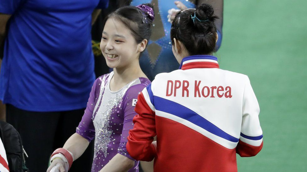 "South Korea""s Lee Eun-ju, left, smiles as she talks with North Korea""s Hong Un Jong during the artistic gymnastics women""s qualification at the 2016 Summer Olympics in Rio de Janeiro, Brazil, Sunday, Aug. 7, 2016."