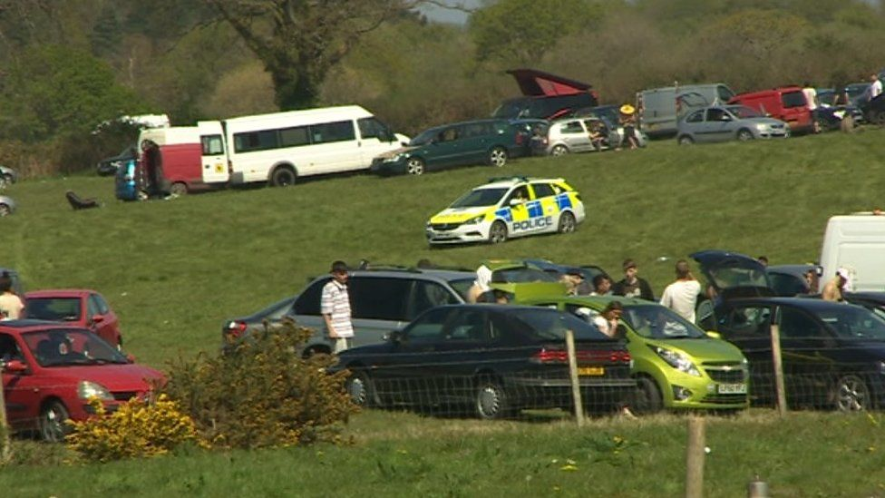 A police car at the site of the rave near Corfe Castle