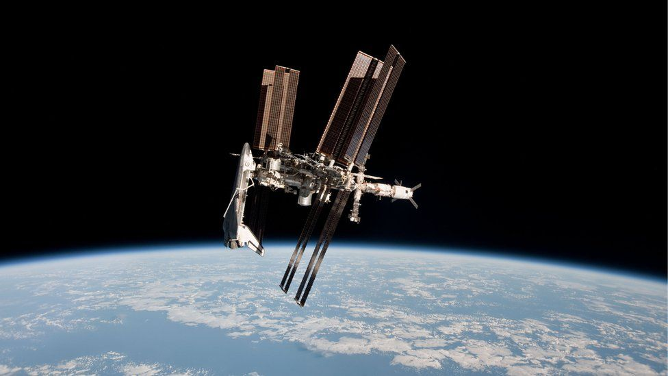 In this handout image provided by the European Space Agency (ESA) and NASA, the International Space Station and the docked space shuttle Endeavour orbit Earth during Endeavour's final sortie on May 23, 2011.