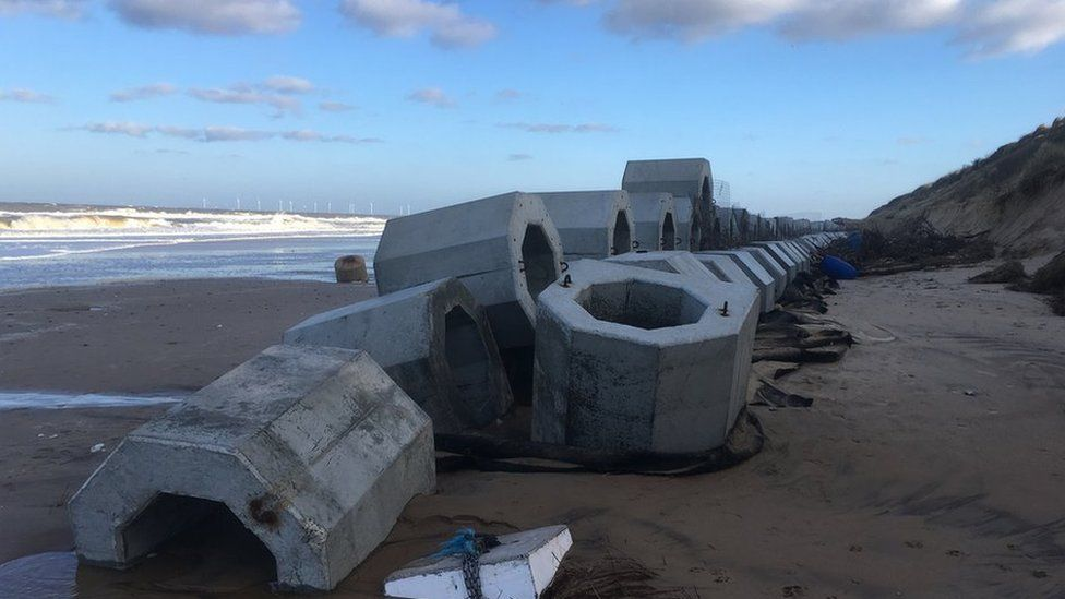 Honeycombed-shaped sea defences paid for by villagers
