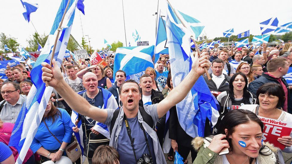 A crowd of Scottish independence supporters waiving Scottish flags