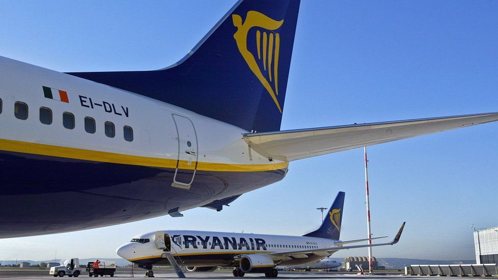 Two Ryanair planes at an airport