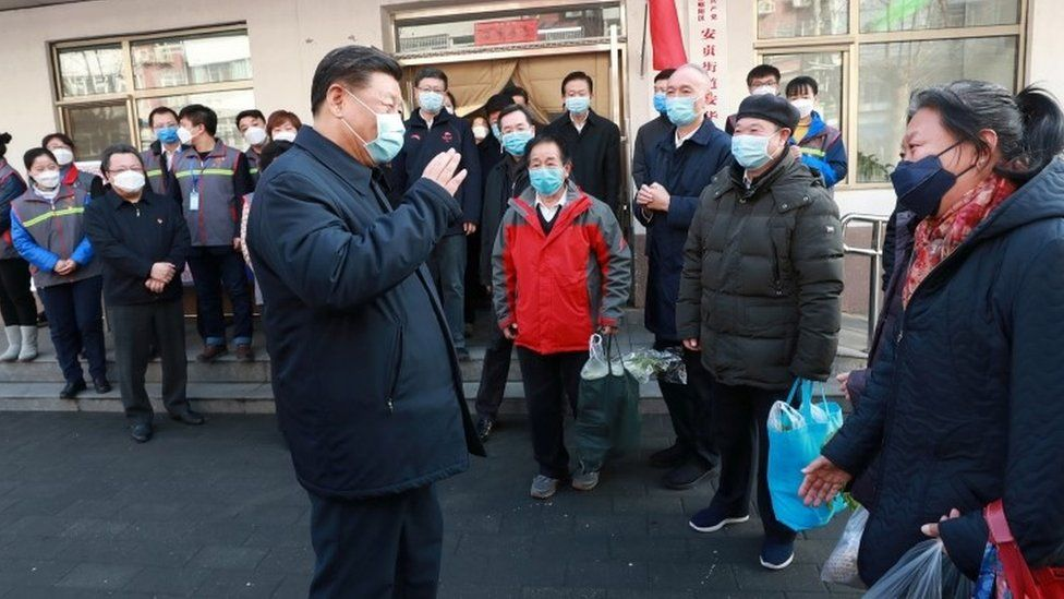 Chinese President Xi Jinping inspects the novel coronavirus prevention and control work at Anhuali Community in Beijing