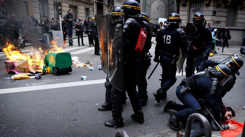 Riot police clashes with protesters during a SNCF French national railways strike in Paris