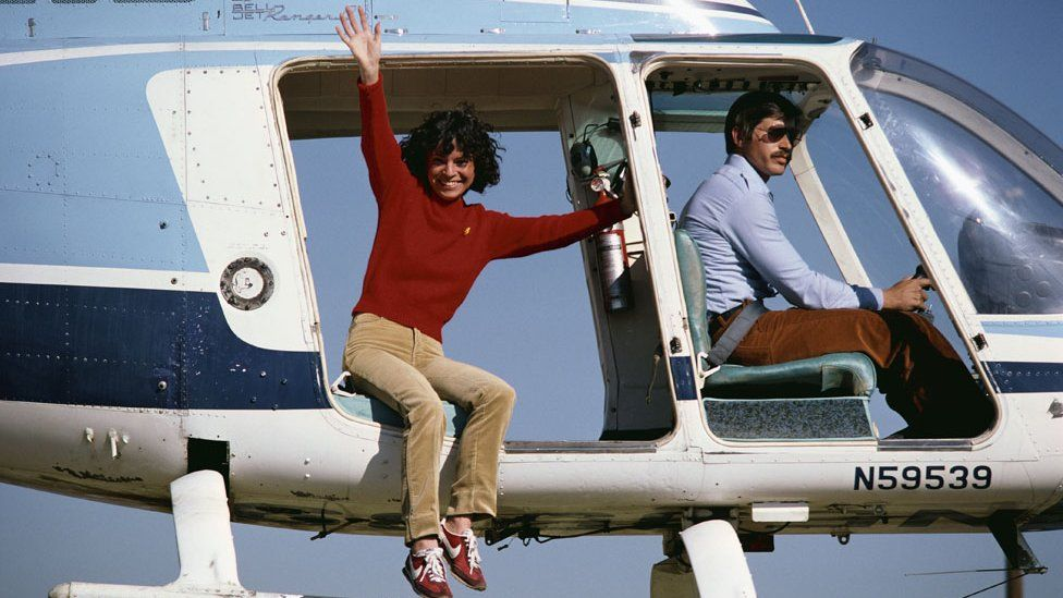 Kitty O'Neil with unnamed helicopter pilot