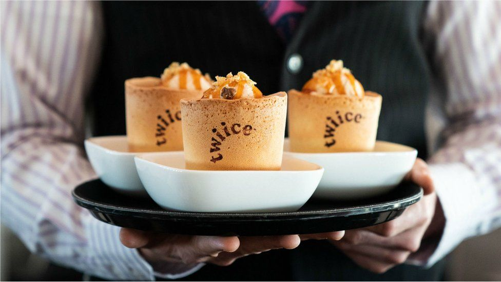 Edible coffee cups are pictured on an Air New Zealand plane
