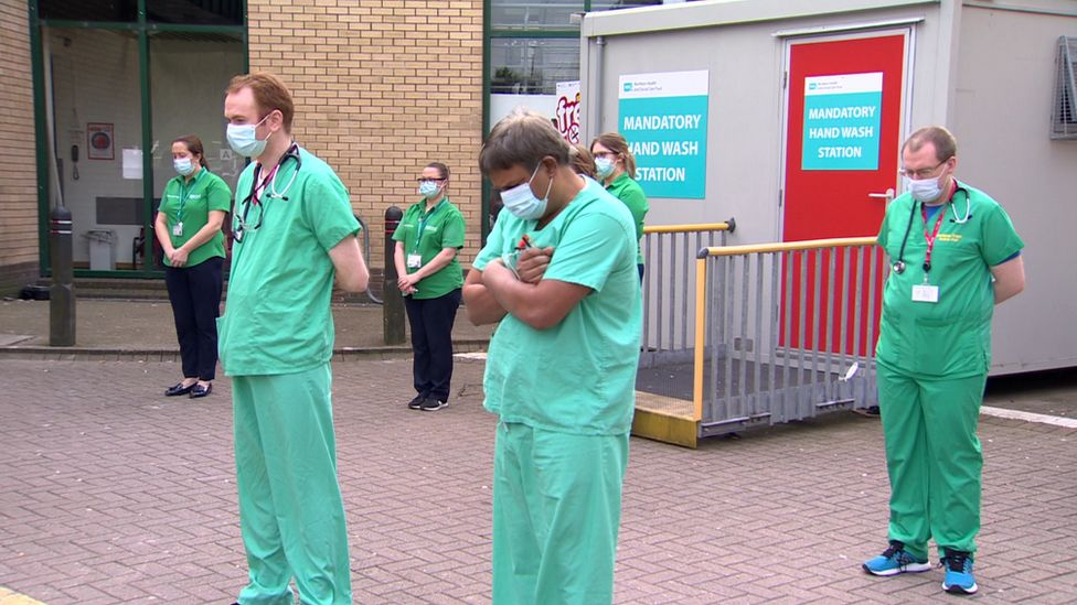 Staff gathered outside Antrim Area Hospital at midday to take part in the minute's silence