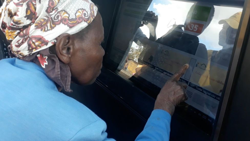 Woman using the community tablet