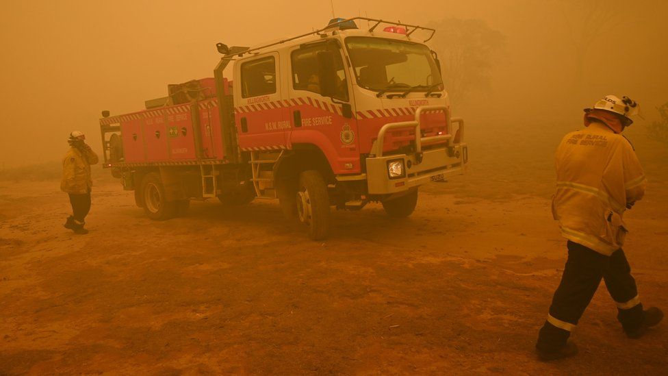 Firefighters and a fire engine near Canberra