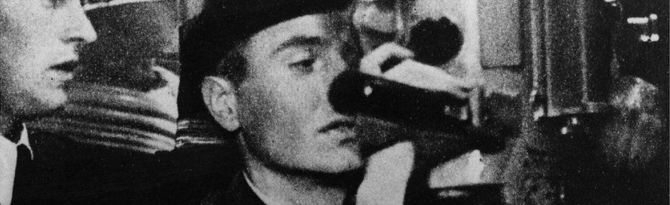 Aboard a German U-boat a seaman is learning how to use the periscope, circa 1941