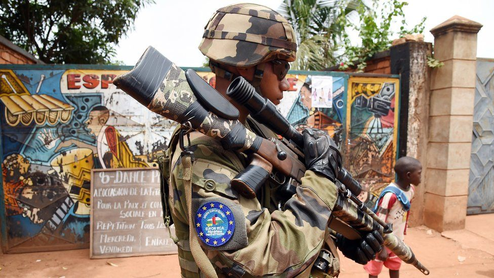 A soldier of the European Union Force (Eufor) in the Central African Republic patrols a street in Bangui (8 May 2014)