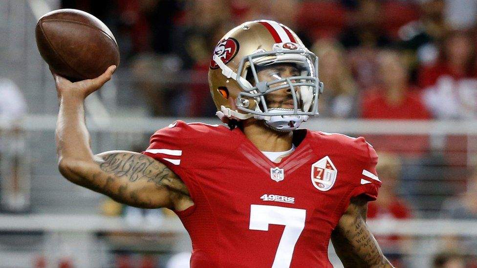Colin Kaepernick throws a ball during a game