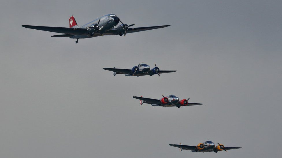 Swissair DC3 and Beech 18s transport planes in formation